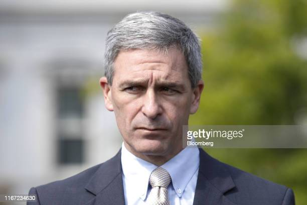 Ken Cuccinelli, acting director of U.S. Citizenship and Immigration Services , pauses while speaking to members of the media following a television...