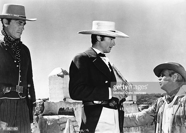 Ken Curtis Laurence Harvey and Richard Widmark on the set of the movie 'The Alamo' in 1960 at the Alamo Village producer and star John Wayne built...
