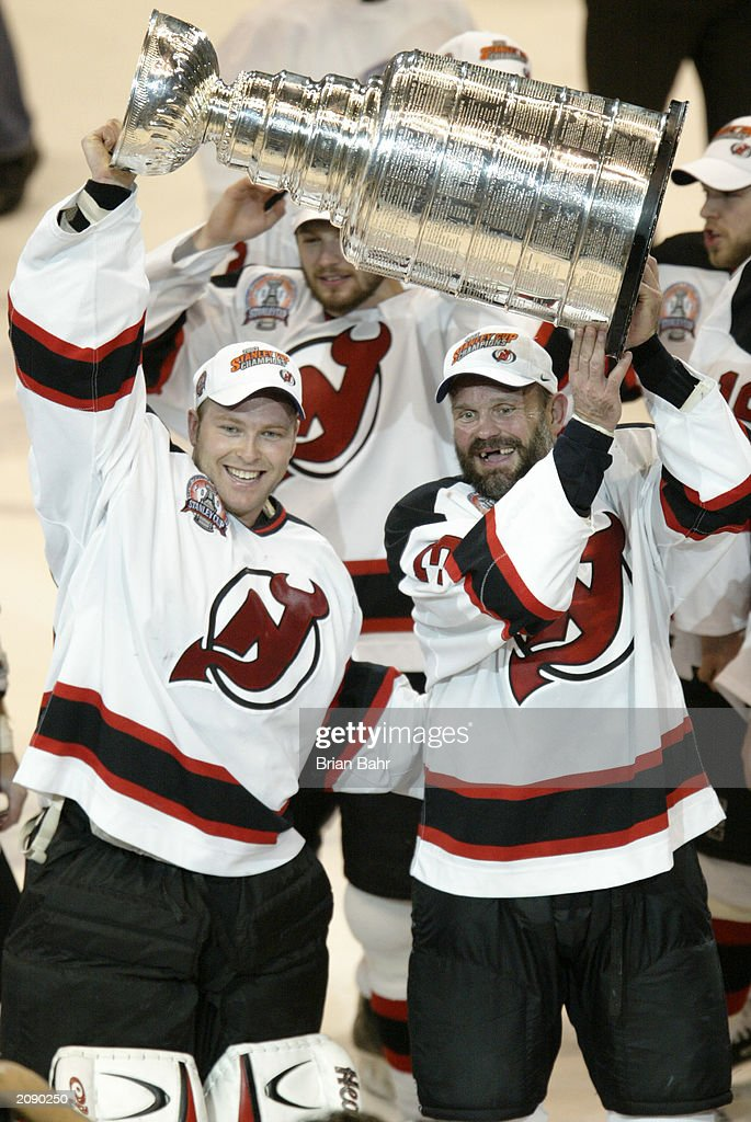 Ken Daneyko And Martin Brodeur Of The New Jersey Devils Raises The