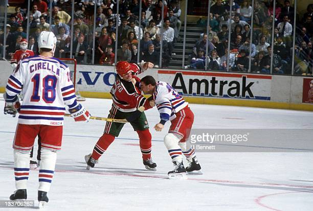 Ken Daneyko of the New Jersey Devils fights with Tie Domi of the New York Rangers on February 13, 1991 at the Madison Square Garden in New York, New...