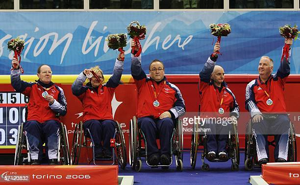 Ken Dickson Angie Malone Tom Killin Michael McCreadie and Frank Duffy celebrate winning the Silver Medal after the Wheelchair Curling Final between...