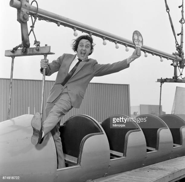 Ken Dodd, appearing in 'The Big Show of 1964' at the Blackpool Opera House, visits the Pleasure Beach. Ken is really trying to lick The Beatles as...