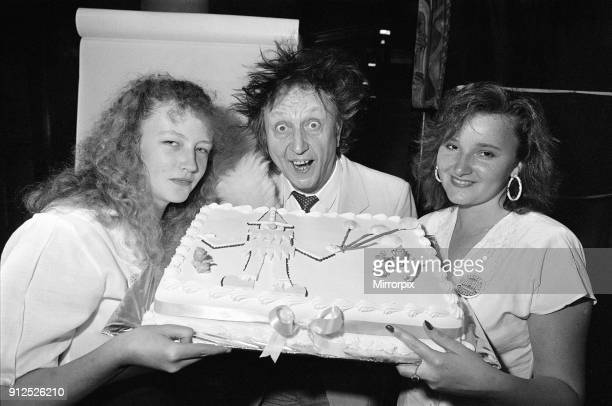 Ken Dodd joins forces with 'Jimbo' the clown and the kids at the Albert Dock party in aid of Alder Hey hospital to celebrate half a million pounds...