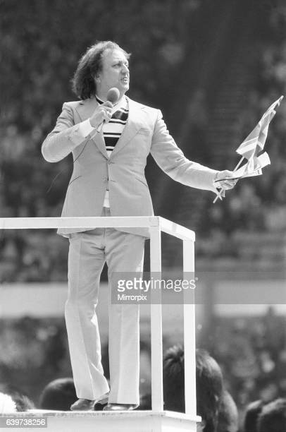 Ken Dodd leads the community singing before the Rugby League Cup Final between Widnes and Hull at Wembley 2nd May 1982