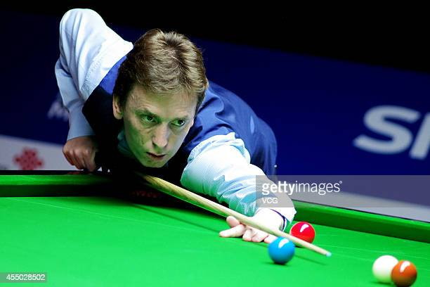 Ken Doherty of Ireland plays a shot in the match against Huang Jiajie of China during day two of the World Snooker Bank of Communications OTO...
