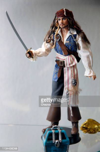 Ken doll representing US actor Johnny Depp is displayed during an exceptional exhibition dedicated to the Barbie doll at 'La Nef des jouets' on March...