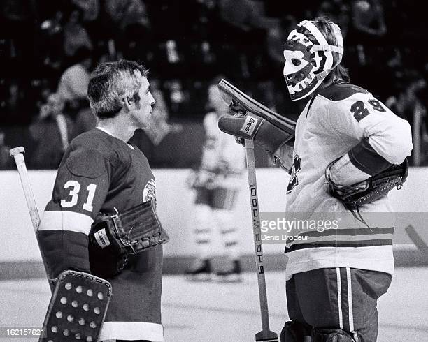Ken Dryden of the Montreal Canadiens has a chat with Ed Giacomin of the Detroit Red Wings at the Montreal Forum circa 1975 in Montreal Quebec Canada