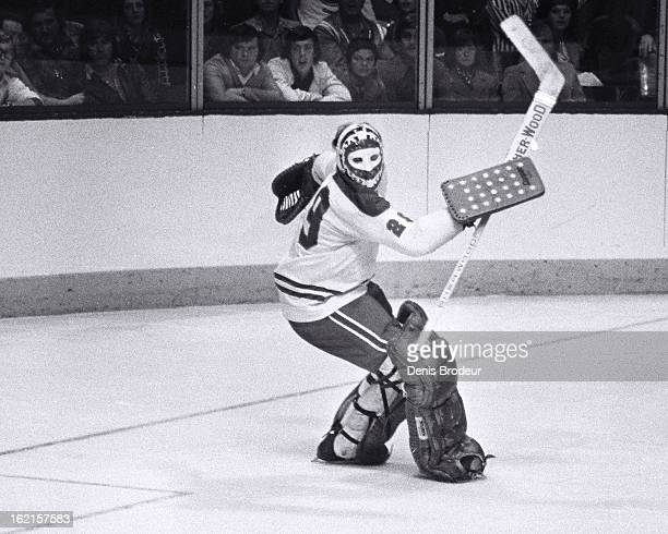 Ken Dryden of the Montreal Canadiens tries to get sight of the puck during a game at the Montreal Forum circa 1975 in Montreal Quebec Canada