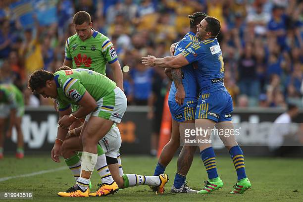 Ken Edwards of the Eels celebrates with his team mate Michael Gordon of the Eels after scoring a try during the round six NRL match between the...