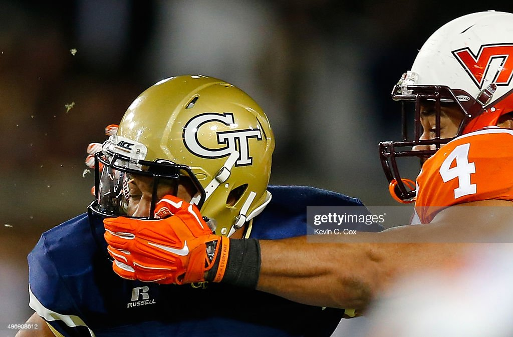 Ken Ekanem #4 of the Virginia Tech Hokies is flagged for a facemask against Justin Thomas #5 of the Georgia Tech Yellow Jackets at Bobby Dodd Stadium on November 12, 2015 in Atlanta, Georgia.