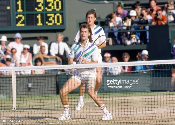 Ken Flach and Robert Seguso of the United States in action against Andres Gomez of Ecuador and Slobodan Zivojinovic of Yugoslavia during the Men's...
