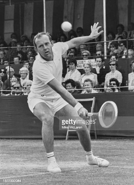 Ken Fletcher of Australia looks at the tennis ball as he makes a forehand return against compatriot Owen Davidson during their Men's Singles Final...