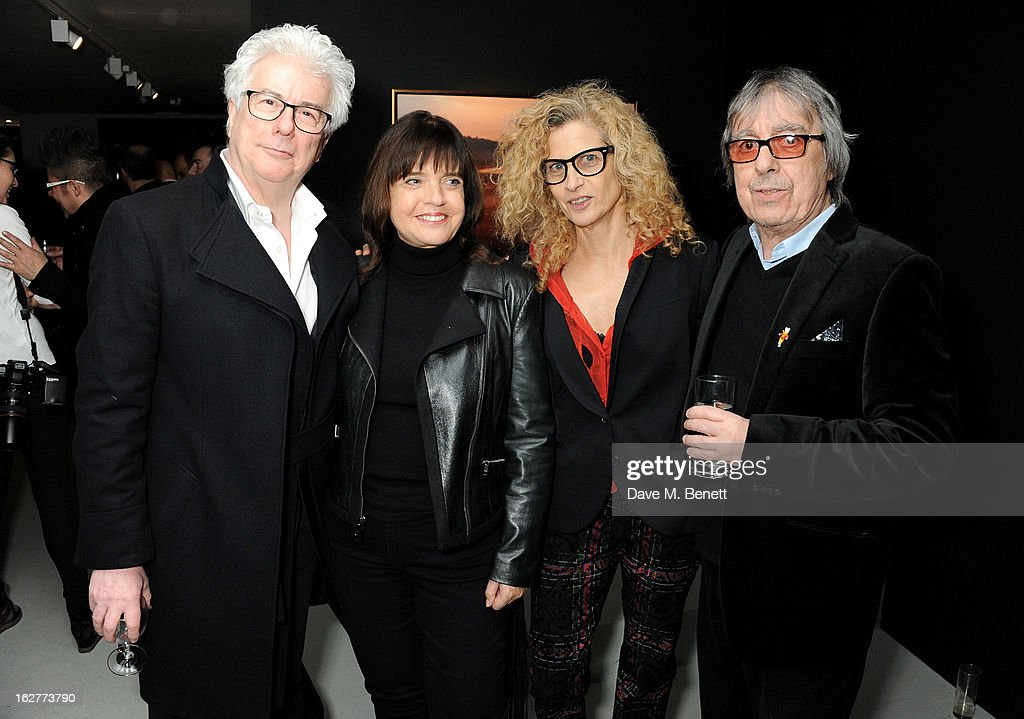 Ken Follett, Barbara Follett, Suzanne Wyman and Bill Wyman attend a private view of Bill Wyman's new exhibit 'Reworked' at Rook & Raven Gallery on February 26, 2013 in London, England.