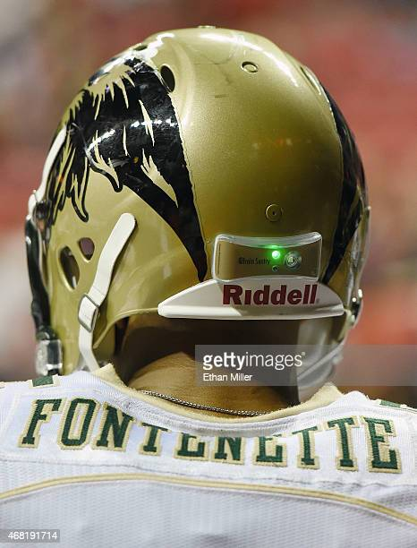Ken Fontenette of the San Jose SaberCats wears a helmet with a Brain Sentry impact sensor on the back during the Las Vegas Outlaws' inaugural home...