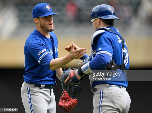 Ken Giles and Danny Jansen of the Toronto Blue Jays celebrate defeating the Minnesota Twins after the game on April 18 2019 at Target Field in...
