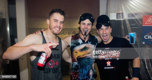 Ken Giles Josh Reddick and Alex Bregman of the Houston Astros celebrate after winning the American League West division at Minute Maid Park on...