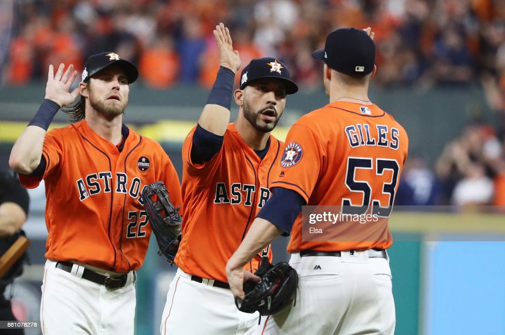 Ken Giles #53 of the Houston Astros celebrates their 2 to 1 win over the New York Yankees with Marwin Gonzalez #9 and Josh Reddick #22 during game one of the American League Championship Series at Minute Maid Park on October 13, 2017 in Houston, Texas.