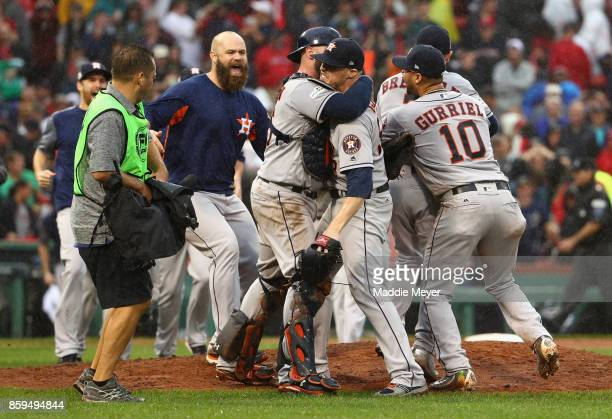 Ken Giles of the Houston Astros celebrates with Brian McCann after recording the final out in the ninth inning to defeat the Boston Red Sox 54 in...