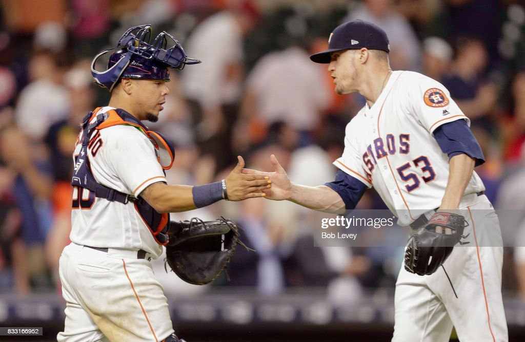 Ken Giles #53 of the Houston Astros shakes hands with Juan Centeno #30 after the final out against the Arizona Diamondbacks at Minute Maid Park on August 16, 2017 in Houston, Texas.