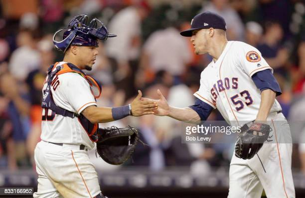 Ken Giles of the Houston Astros shakes hands with Juan Centeno after the final out against the Arizona Diamondbacks at Minute Maid Park on August 16...