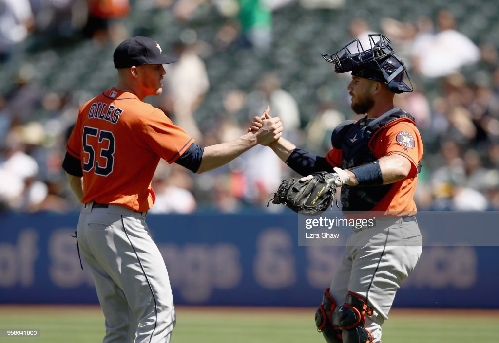 Ken Giles #53 of the Houston Astros shakes hands with Max Stassi #12 after they beat the Oakland Athletics at Oakland Alameda Coliseum on May 9, 2018 in Oakland, California.