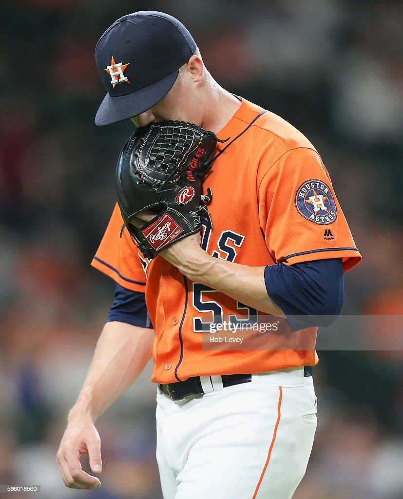 Ken Giles #53 of the Houston Astros yells into his glove as he leaves the mound in he ninth inning against the Tampa Bay Rays at Minute Maid Park on August 26, 2016 in Houston, Texas.