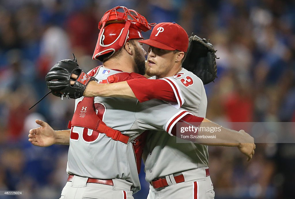 Ken Giles #53 of the Philadelphia Phillies celebrates their victory with Cameron Rupp #29 during MLB game action against the Toronto Blue Jays on July 28, 2015 at Rogers Centre in Toronto, Ontario, Canada.