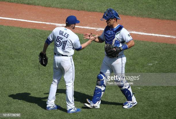 Ken Giles of the Toronto Blue Jays celebrates their victory with Luke Maile during MLB game action against the Tampa Bay Rays at Rogers Centre on...