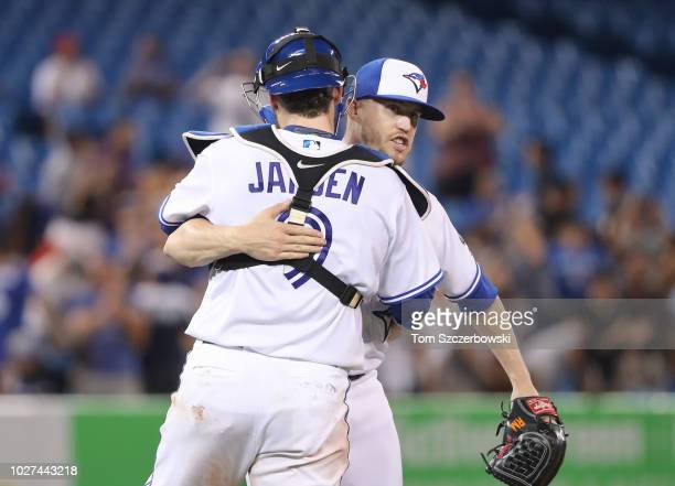 Ken Giles of the Toronto Blue Jays celebrates their victory with Danny Jansen during MLB game action against the Tampa Bay Rays at Rogers Centre on...