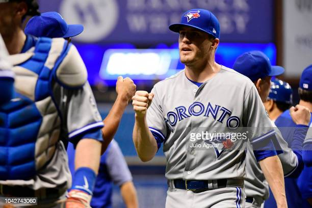 Ken Giles of the Toronto Blue Jays celebrates with teammates after beating the Tampa Bay Rays 76 on September 28 2018 at Tropicana Field in St...