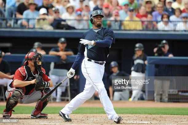 Ken Griffey Jr #24 of the Seattle Mariners at bat during a Spring Training game against the Arizona Diamondbacks at Peoria Stadium on March 8 2009 in...