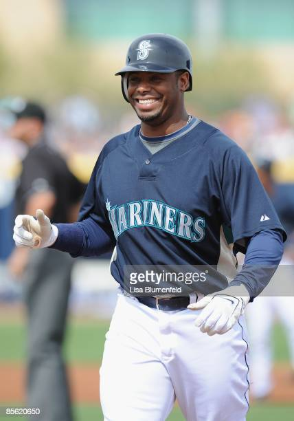 Ken Griffey Jr #24 of the Seattle Mariners looks on from first base during a Spring Training game against the Arizona Diamondbacks at Peoria Stadium...