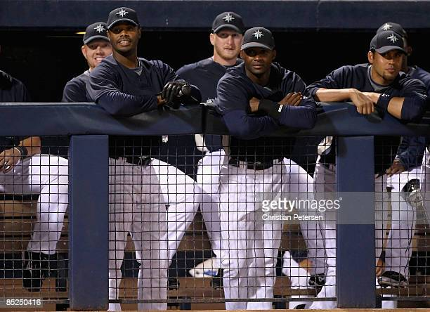 Ken Griffey Jr. #24 of the Seattle Mariners looks on from the dugout during the spring training game against Team Australia at Peoria Stadium on...