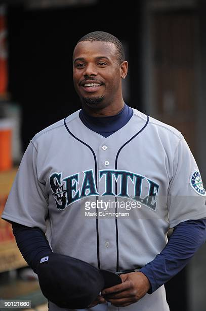 Ken Griffey Jr #24 of the Seattle Mariners looks on from the dugout against the Detroit Tigers during the game at Comerica Park on August 19 2009 in...