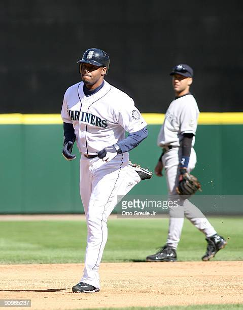 Ken Griffey Jr #24 of the Seattle Mariners rounds the bases past shortstop Derek Jeter of the New York Yankees after hitting a threerun homer on...