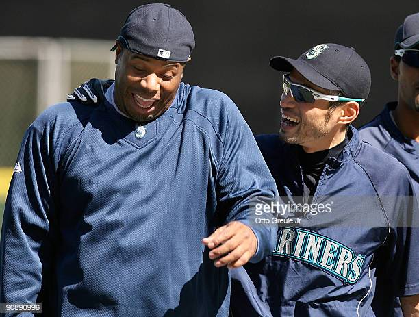 Ken Griffey Jr #24 of the Seattle Mariners shares a laugh with Ichiro Suzuki after batting practice prior to the game against the Chicago White Sox...