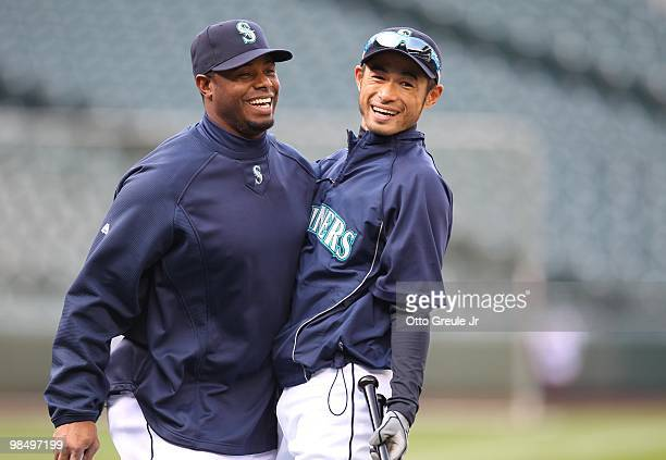 Ken Griffey Jr #24 of the Seattle Mariners talks with Ichiro Suzuki during batting practice prior to the game against the Oakland Athletics at Safeco...