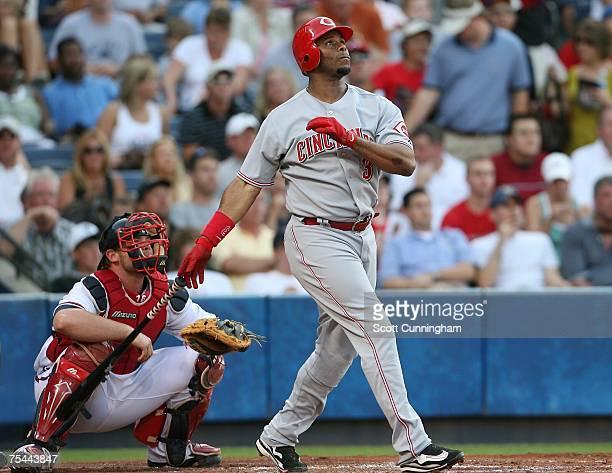 Ken Griffey Jr #3 of the Cincinnati Reds hits a second inning home run against the Atlanta Braves at Turner Field on July 16 2007 in Atlanta Georgia...