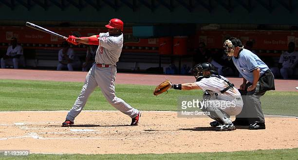 Ken Griffey Jr. #3 of the Cincinnati Reds hits a single during a game against the Florida Marlins on June 8, 2008 at Dolphin Stadium in Miami,...
