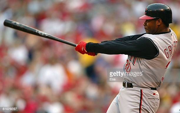 Ken Griffey Jr #30 of the Cincinnati Reds gets a hit in the second inning against the St Louis Cardinals July 6 2004 at Busch Stadium in St Louis...
