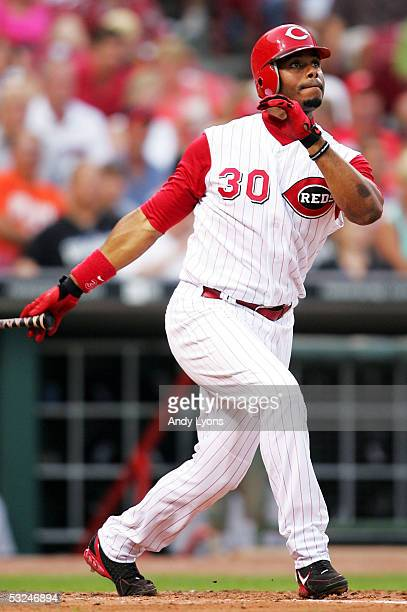 Ken Griffey Jr. #30 of the Cincinnati Reds hits a 4th inning home off of Jeff Francis of the Colorado Rockies on July 16, 2005 at Great American...