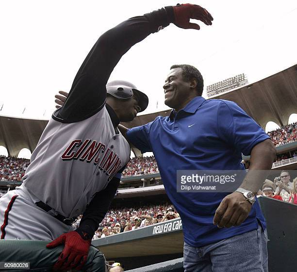 Ken Griffey Jr #30 of the Cincinnati Reds is congratulated by his father Ken Griffey Sr after junior hit his 500th career home run in the sixth...