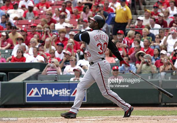 Ken Griffey Jr #30 of the Cincinnati Reds watches his 500th career home run clear the wall in the sixth inning off of pitcher Matt Morris of the St...