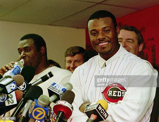 Ken Griffey Jr accompanied by his father Ken Griffey Sr speaks to the press during a press conference in Cincinnati Ohio 10 February 2000 Griffey was...