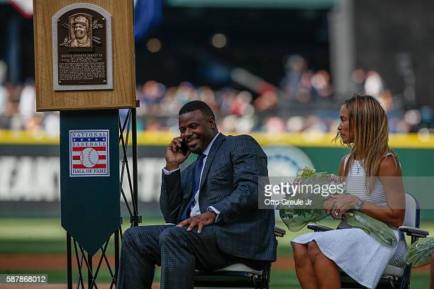Ken Griffey Jr calls Willie Mays on his cell phone after Mays told Griffey Jr to call him anytime via video appearance during a jersey retirement...