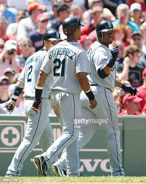 Ken Griffey Jr Franklin Gutierrez and Kenji Johjima of the Seattle Mariners celebrate after scoring in the fourth inning against the Boston Red Sox...