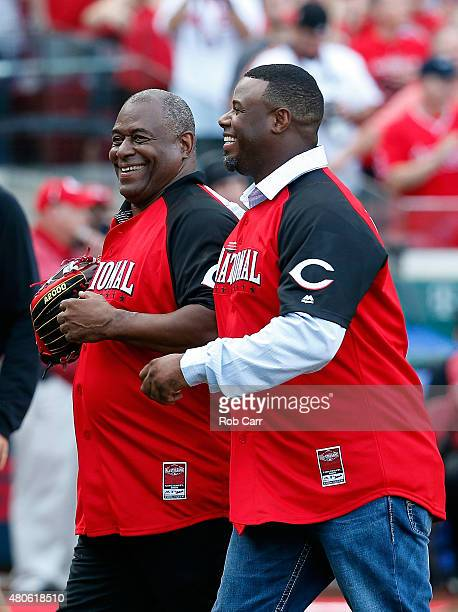 Ken Griffey Jr hugs his father Ken Griffey Sr after throwing out the first pitch prior to the Gillette Home Run Derby presented by Head Shoulders at...