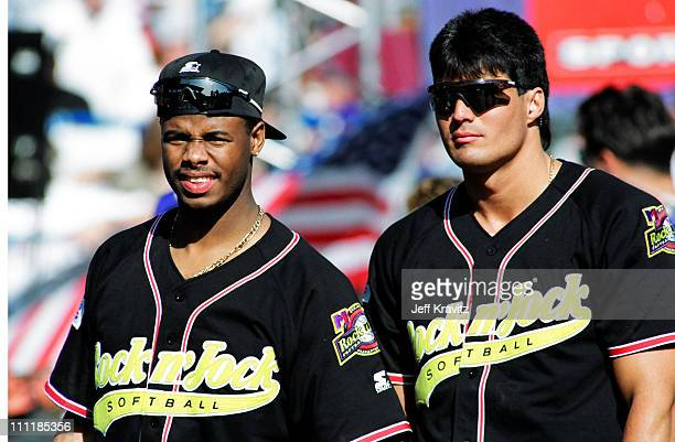 Ken Griffey Jr Jose Canseco during MTV's 3rd Annual Rock 'n Jock Softball at Memorial Park in Long Beach California United States