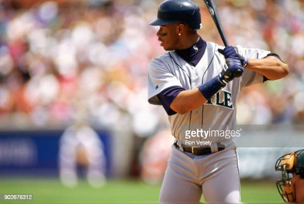 Ken Griffey Jr of the Seattle Mariners bats during an MLB game against the Oakland Athletics at the OaklandAlameda County Coliseum during the 1988...