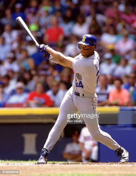 Ken Griffey Jr of the Seattle Mariners bats during an MLB game against the Cleveland Indians at Municipal Stadium in Cleveland Ohio during the 1990...